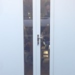 Openslaande-garagedeuren-verticaal-glas-geisoleerd-320x180