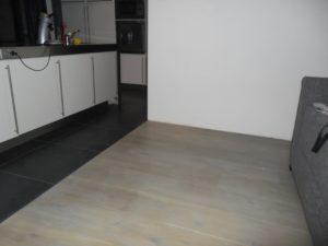 Houten vloer laten leggen in de woonkamer woning klussers